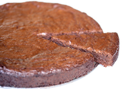 photo of a Flourless Chocolate Hazelnut Torte with a slice cut out