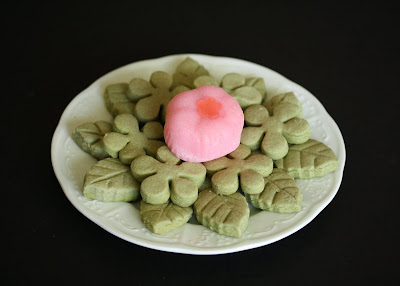 overhead of a plate of cookies with a piece of mochi on top