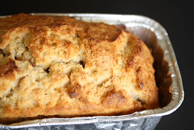close-up photo of a loaf of Honey Beer Bread in a pan