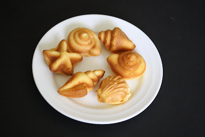 photo of seashell cakelets on a plate
