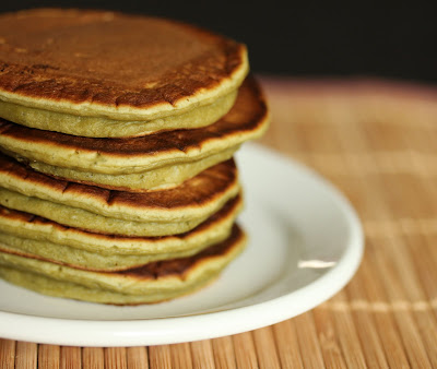 close-up photo of a stack of matcha pancakes