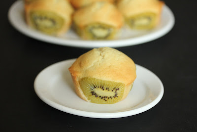 photo of one Kiwi coconut cupcake on a plate