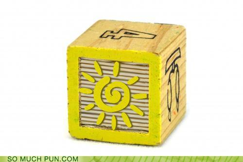 photo of a play block with a sun on it