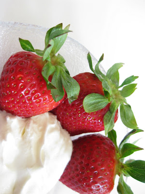 close-up photo of strawberries with whipped cream