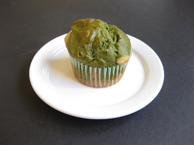 Matcha Green Tea and White Cupcake in a cupcake liner.
