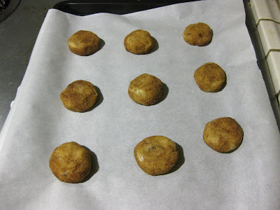photo of the cookie dough balls on a baking sheet