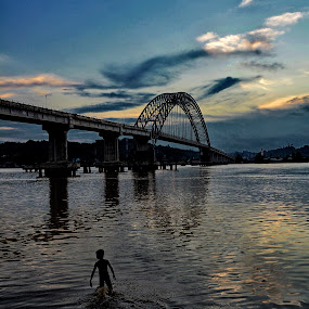 Mahulu Bridge, Borneo - Indonesia by Hans Daniel - Landscapes Waterscapes ( streetphotography, blue sky, waterscape, architecture, bridge, boy,  )