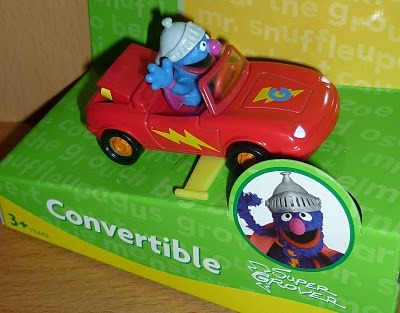 Super Grover in his convertible car