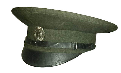 51c0b66b77b The Tunic. The main body of the tunic was made of the grey green serge.  However the tunic had very dark green shoulder straps epaluttes and cointed  cuffs.