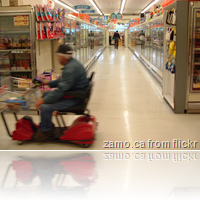 scooter man in supermarket