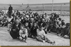 Romani arrivals in the Belzec extermination camp await instructions