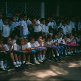 In 1997 several of the trustees and supporters of the Santa Rosa Fund visited Nicaragua and were treated to a display (acto) of folkloric dancing by pupils at the school. This photograph shows some of the pupils (those not performing) lined up waiting to see the acto.