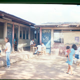 The schoolyard during the holidays in 1988 showing Virginia, the headteacher (who later retired in 2007). Even during the holidays the school served as a focus for community activity.