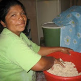 Beneranda Hernández, one of the mothers, helps out by making dough for tortillas