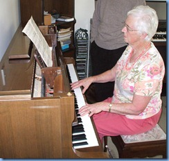 Dorothy Waddel showing her piano talents on the Schimmel