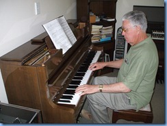 Club Treasurer, Jim Nicholson, enjoying Phyl Briscoe's lovely Schimmel piano