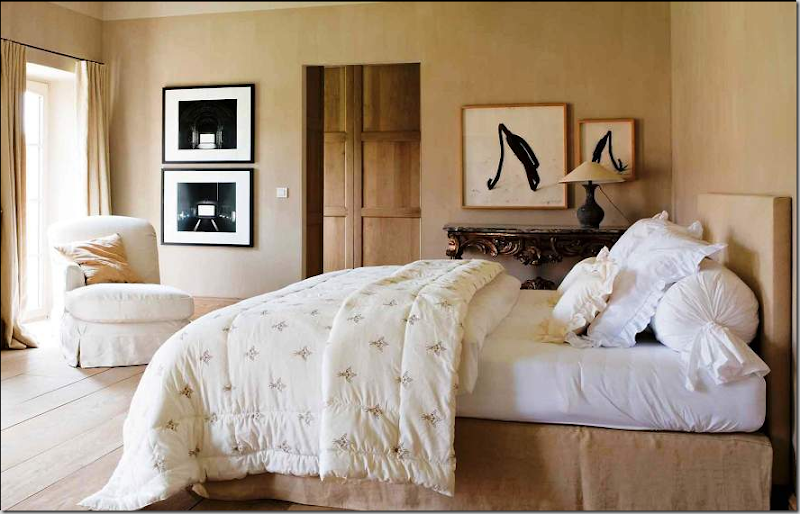 Upstairs  a bedroom with simple limed wood planks and wood doors  Modern  art plays against all the antiques and the age of architecture  itself. COTE DE TEXAS  Belgian Design   Hot  Hot  Hot