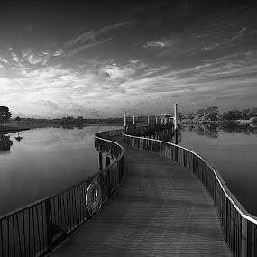 Boardwalk of Solitude by Chester Chen - Black & White Landscapes ( water, clouds, reflection, black and white, infrared, seletar, solitude, jetty, boardwalk, singapore, reservoir, blackandwhite, bridge, sunrise, b&w, landscape )