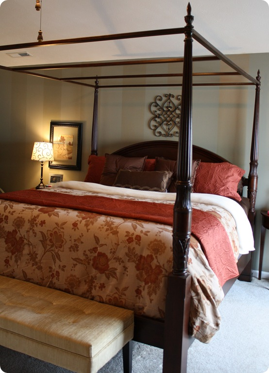 four poster wood bed with warm colors
