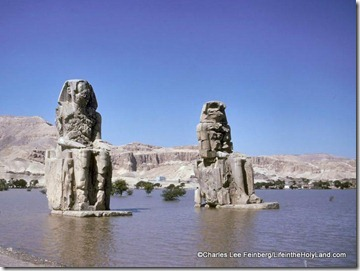 Colossi of Memnon in floodwaters of Nile River, cf34-74