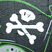 Thumbnail photo of a grafitti skull and crossbones
