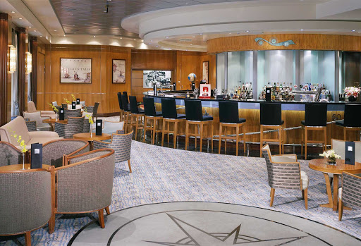 Cunard-Queen-Mary-2-Chart-Room - Head to the sophisticated Chart Room, featuring maritime displays, nautically themed décor and live jazz, for refreshments before or after dinner aboard Queen Mary 2.