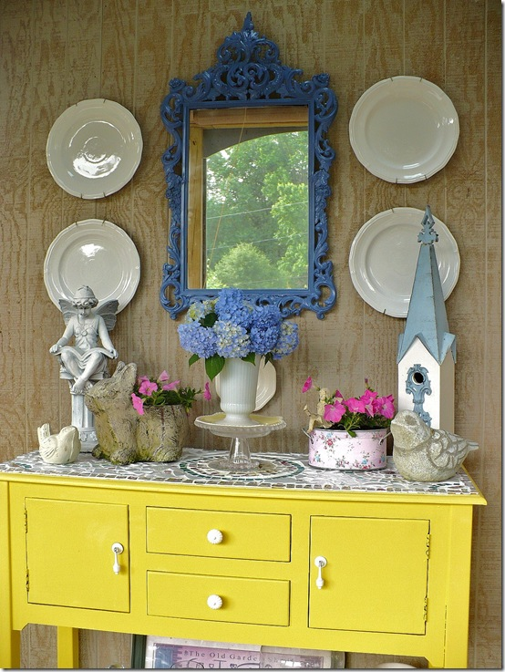 blue mirror over buffet in screened in porch