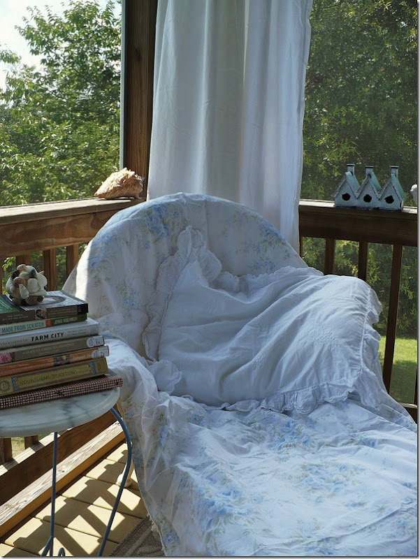 comfy chair with white vintage pillowcase