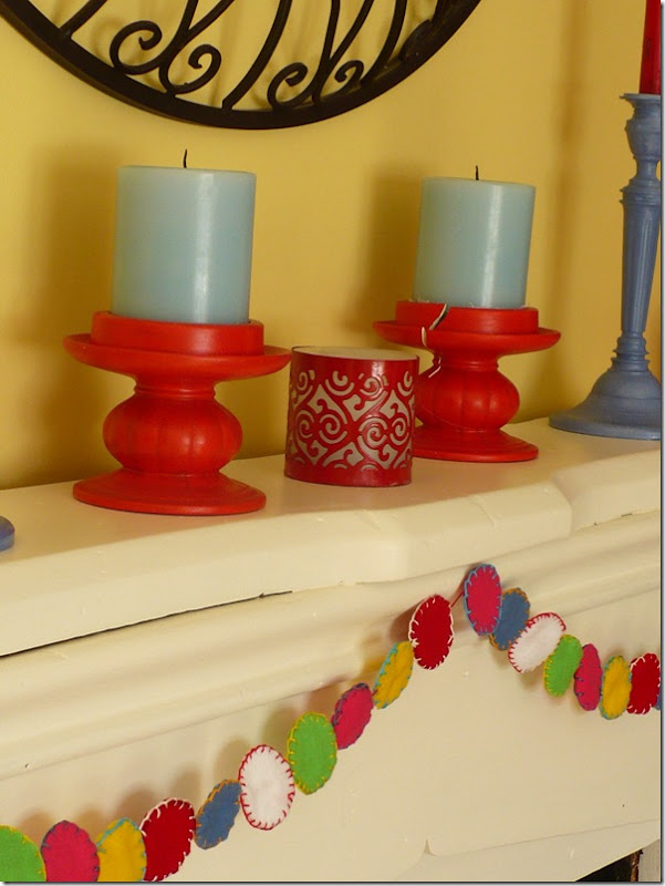 blue candles in red candlesticks