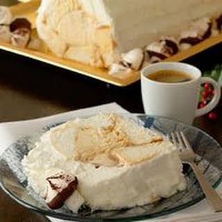 Coconut Yule Log with Meringue Mushrooms.