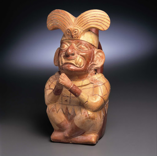Sculptural ceramic ceremonial vessel that represents Ai Apaec, mythological hero of the Moche in a praying attitude