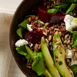 Beet and Arugula Salad with Quinoa, Avocado, and Sunflower Seeds.