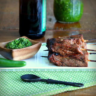 Beer and Sriracha Marinated Beef Skewers with Green Chile Sauce.