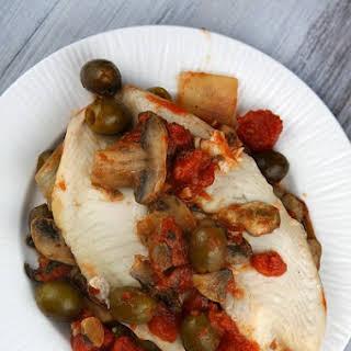 Tilapia w/ Olive, Mushroom & Tomato Sauce.