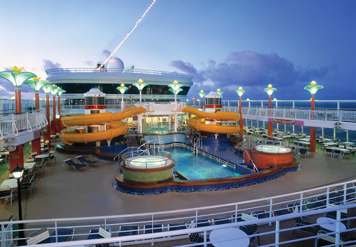 Norwegian-Star-Oasis-Pool - Norwegian Star's Oasis Pool features slides, hot tubs and the Topsider's Bar and Grill nearby.