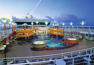 Norwegian Star's Oasis Pool features slides, hot tubs and the Topsider's Bar and Grill nearby.