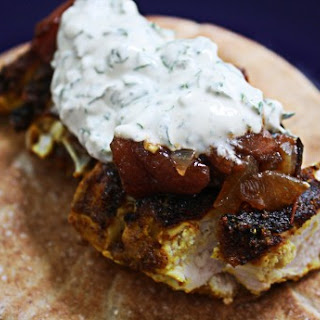 Tandoori Spiced Chicken Breast with Grilled Tomato Jam and Herbed Yogurt Sauce.