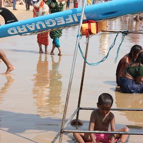 Safe under lifeguard by Thakkar Mj - People Street & Candids ( child, sand, goa, street, safe guard, candid, india, beach, street photography,  )