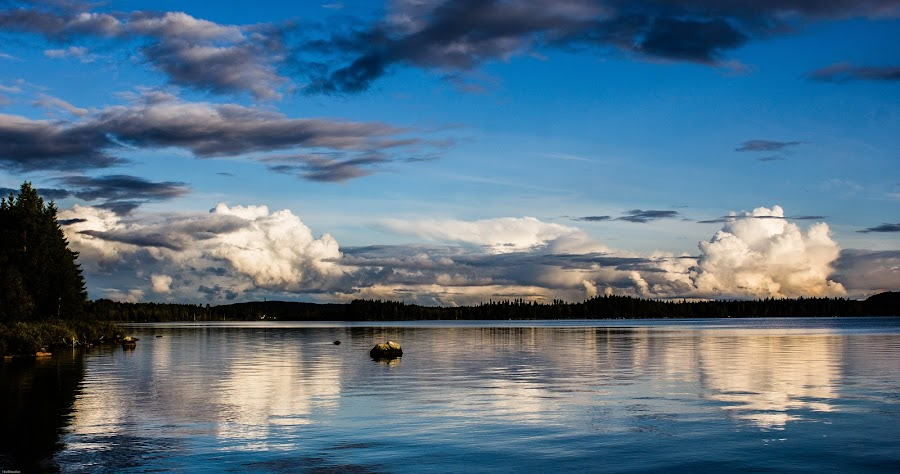 By the water by Erika Lorde - Landscapes Waterscapes ( calm, clouds, water, reflection, blue, landscape )