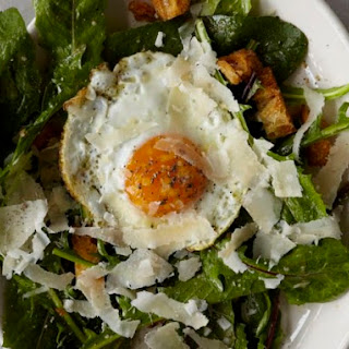 Dandelion Greens with a Fried Egg, Croutons, and Anchovy Dressing from 'Franny's'
