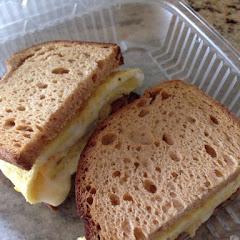 Breakfast sandwich (egg, cheese, bacon) with gluten free bread