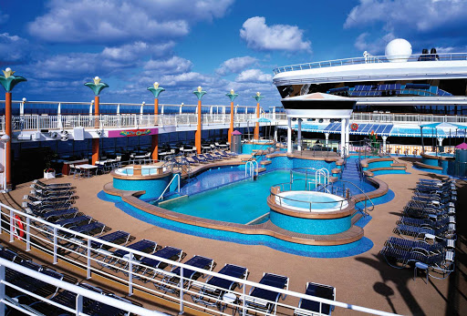 Norwegian-Dawn-Pool-Deck - Spend time on Norwegian Dawn's pool deck for a swim in the pool or a relaxing soak in the whirlpool.