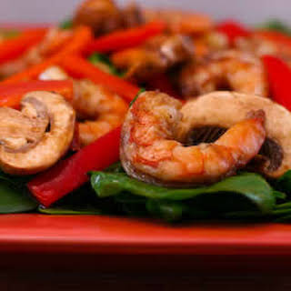Asian Spinach Salad with Shrimp, Red Pepper, and Mushrooms.