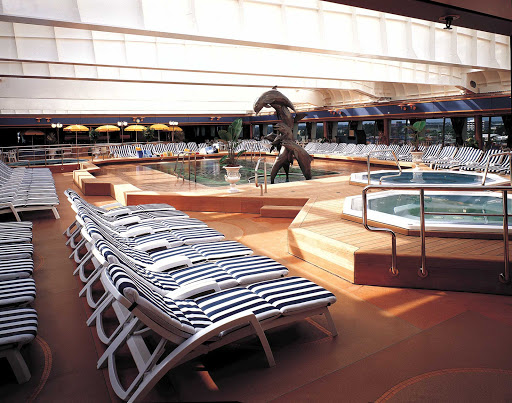 Holland-America-SClass-Lido-Pool-Midship - The fresh water Lido Pool at midship aboard your Holland America Line ship with its sculptural trio of dolphins. (This is a shot of Statendam; her sister ships Maasdam, Ryndam and Veendam are nearly identical.)