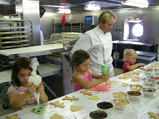 Junior-Cruisers-Kids-Baking-Cookies-in-the-Galley - Children can visit the Galley and take a turn baking with the Junior Cruisers on a Crystal cruise.