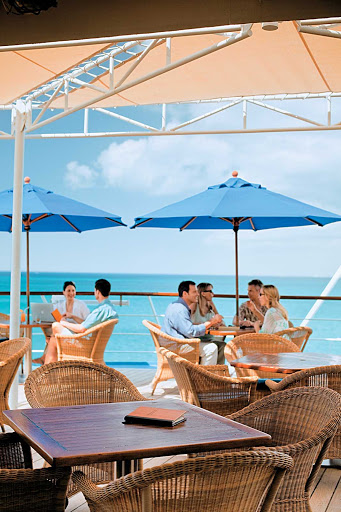 Windstar-Cruises-Compass-Rose-on-deck - Grab a drink or bite on deck at the Compass Rose and take in the sweeping panoramas during your sailing on Wind Star.
