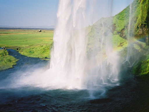 Photo taken from behind Seljalandsfoss, a spectacular waterfall in Iceland.