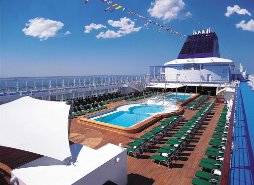 Norwegian-Sky-Lido-deck-pool - Norwegian Sky guests have plenty of space to sunbathe and lounge on deck, then jump into the pool for a   swim.