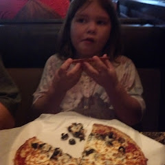 My Celiac kiddo with her gf pizza...she said it is YUMMY!