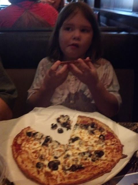 My Celiac kiddo with her gf pizza...she said it is YUMMY!
